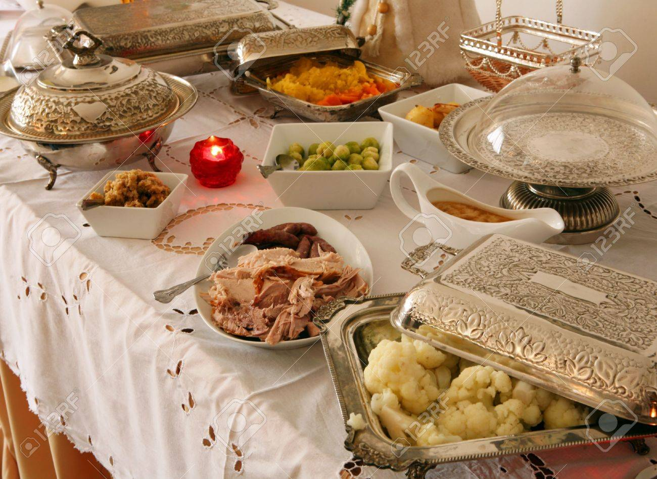 A Christmas Buffet Table, With Silverware Containing All The ...