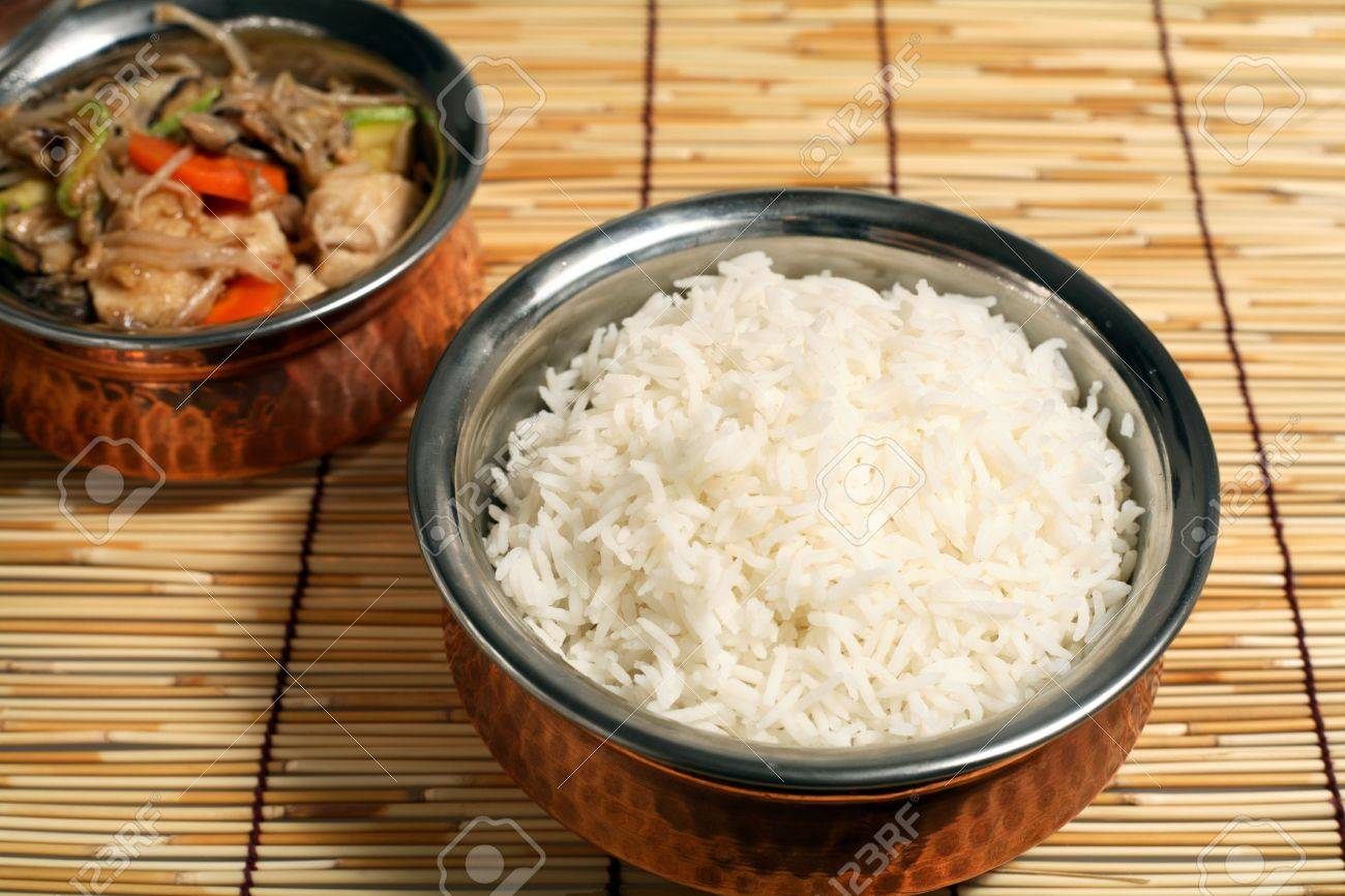 A Serving Bowl With White Rice And A Bowl Of Chinese Chicken Stock Photo Picture And Royalty Free Image Image 2230824