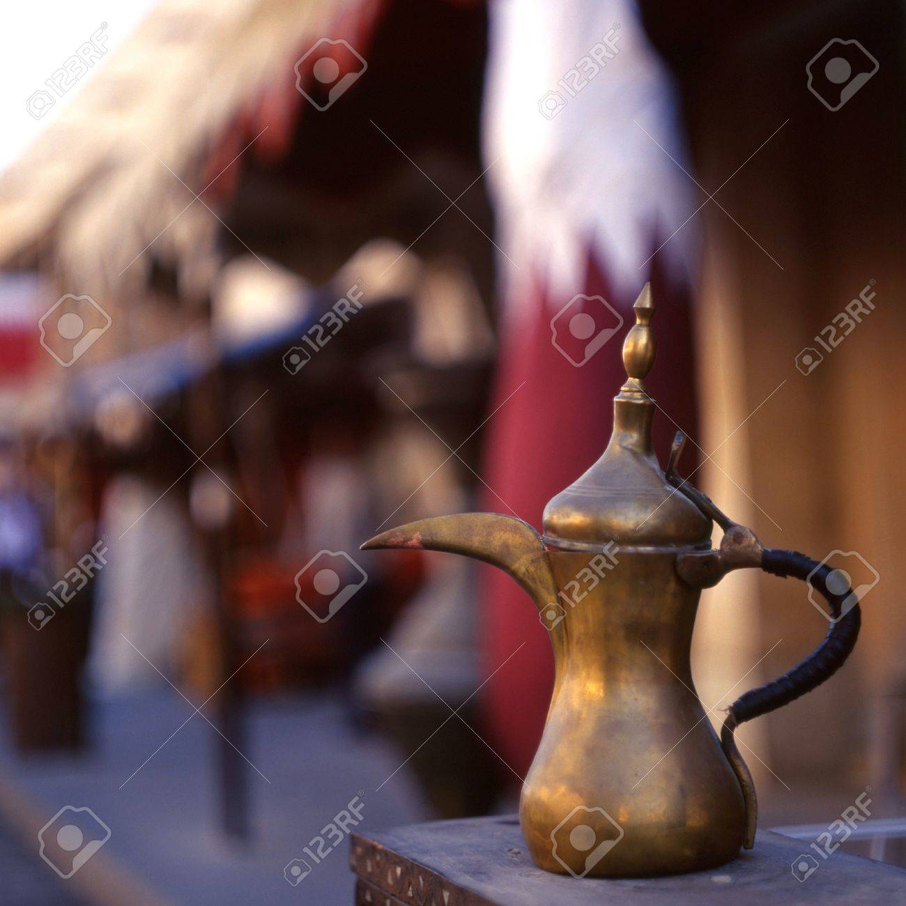 A coffee pot the arab symbol of welcome in front of a qatari a coffee pot the arab symbol of welcome in front of a qatari flag biocorpaavc Gallery