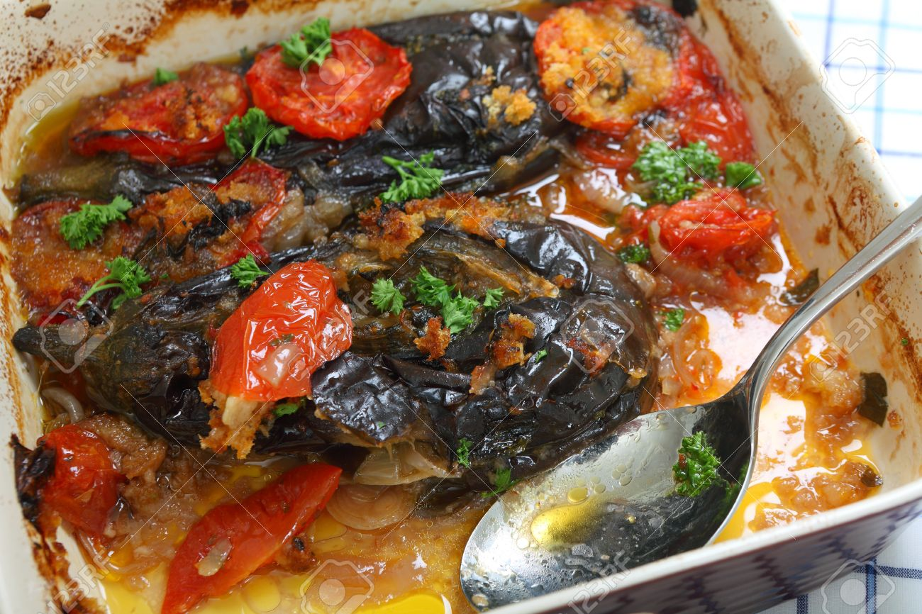 The greek and turkish speciality imam baildi eggplant baked stock stock photo the greek and turkish speciality imam baildi eggplant baked in olive oil with onion tomato garlic parsley topped with bread crumbs forumfinder