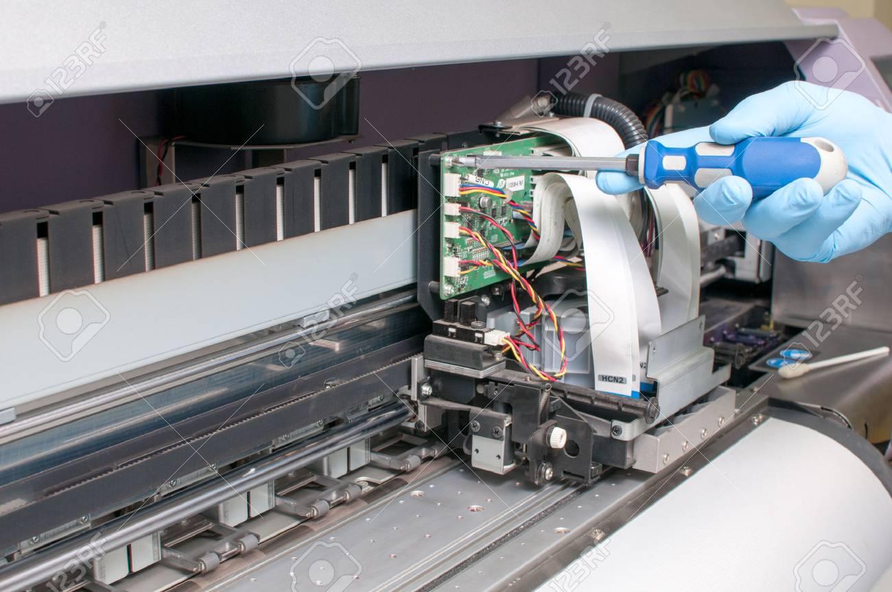 man repairing a printer - 54938006