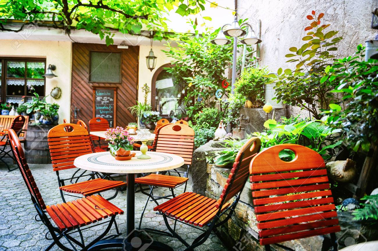 cafe terrace in small european city at summer day stock photo