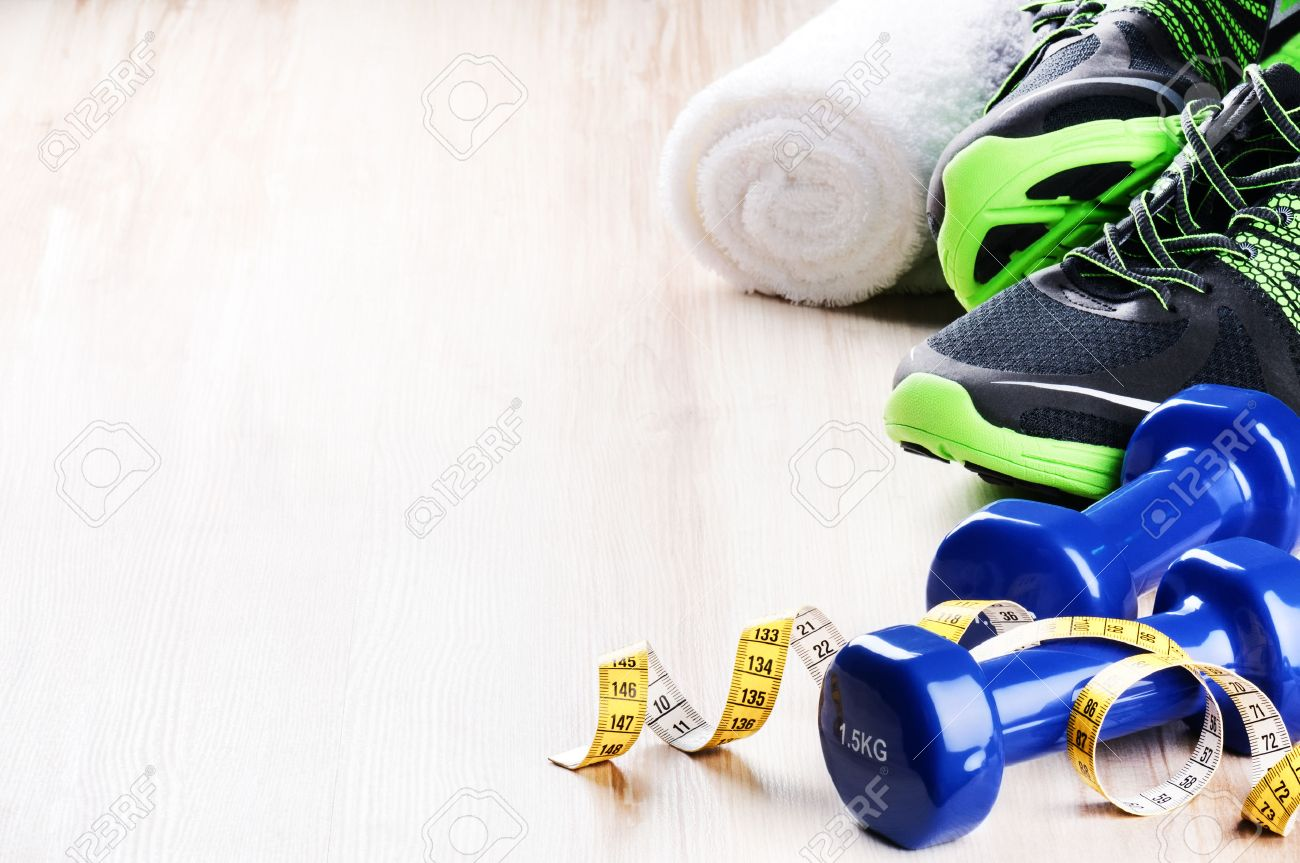 Fitness concept with dumbbells,  sneakers and measuring tape Stock Photo - 38203642