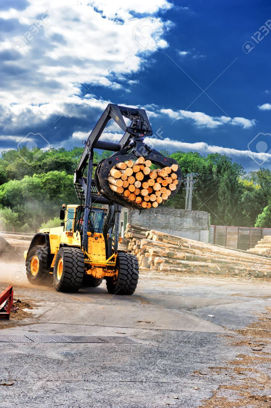 Forklift truck hauling logs at sawmill  Industrial concept with