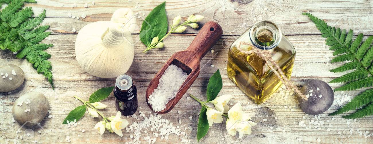 Spa setting with jasmine essential oil and flowers. Wellness concept, top view - 57557232