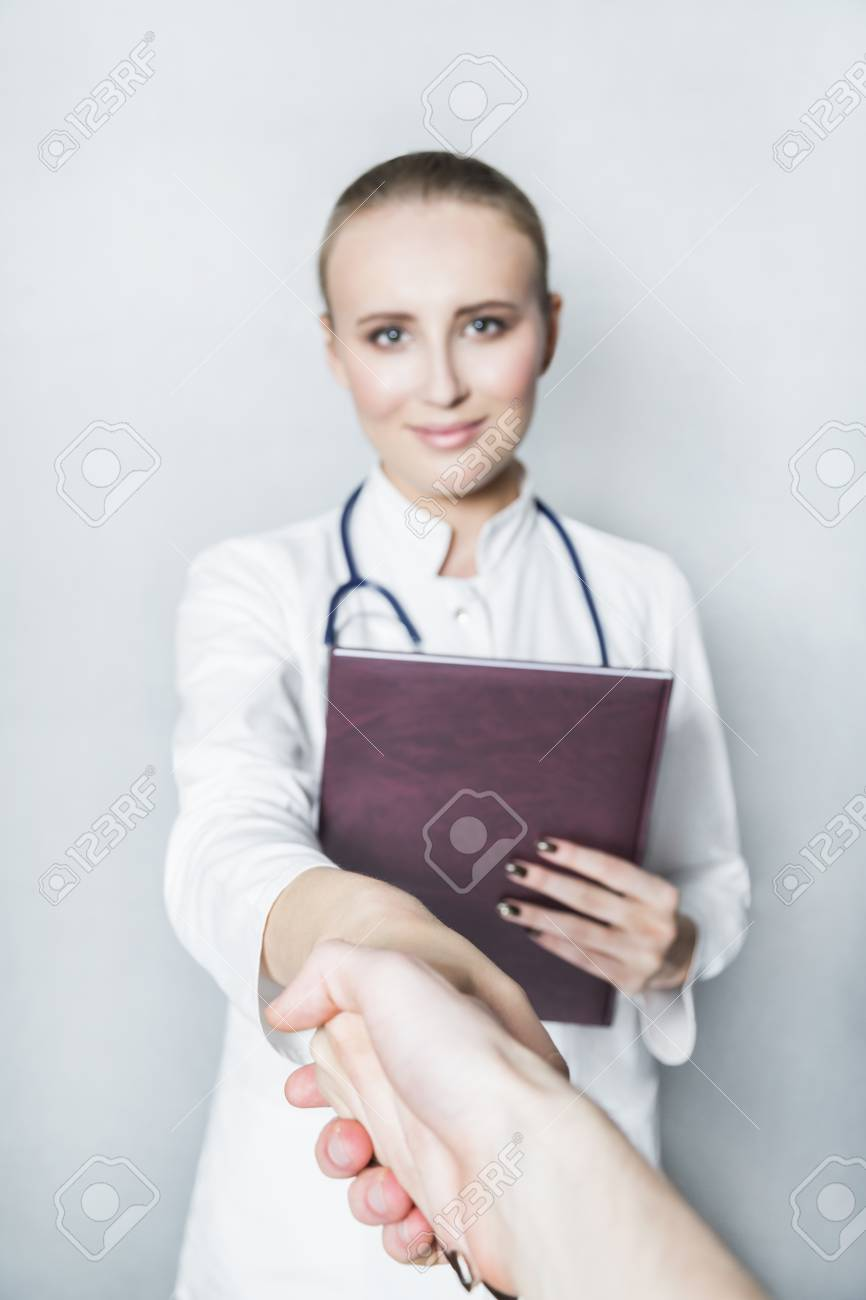 Doctor In White Gown And With Stethoscope On Neck Shakes Hands Stock ...