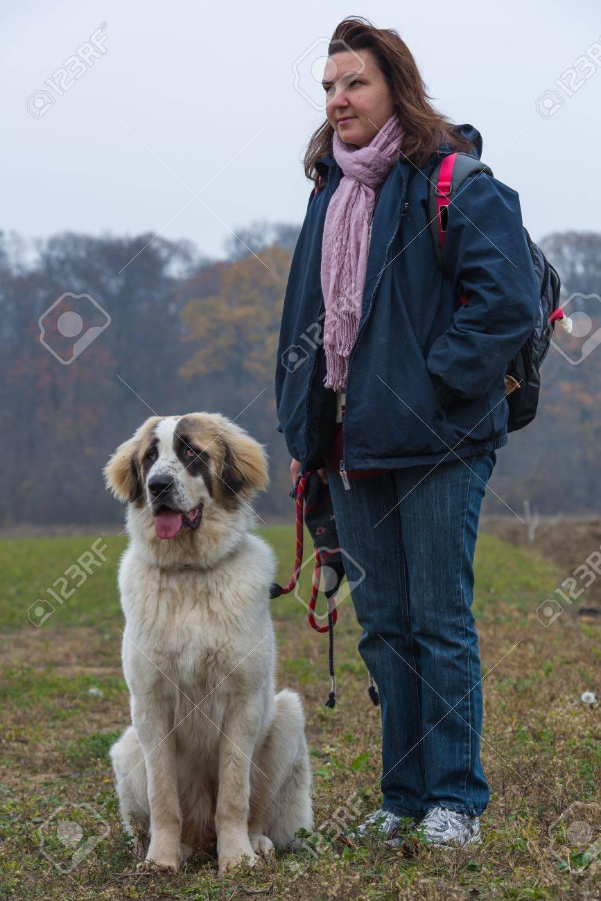 Young girl training her Bucovina shepherd dog Stock Photo - 16763774