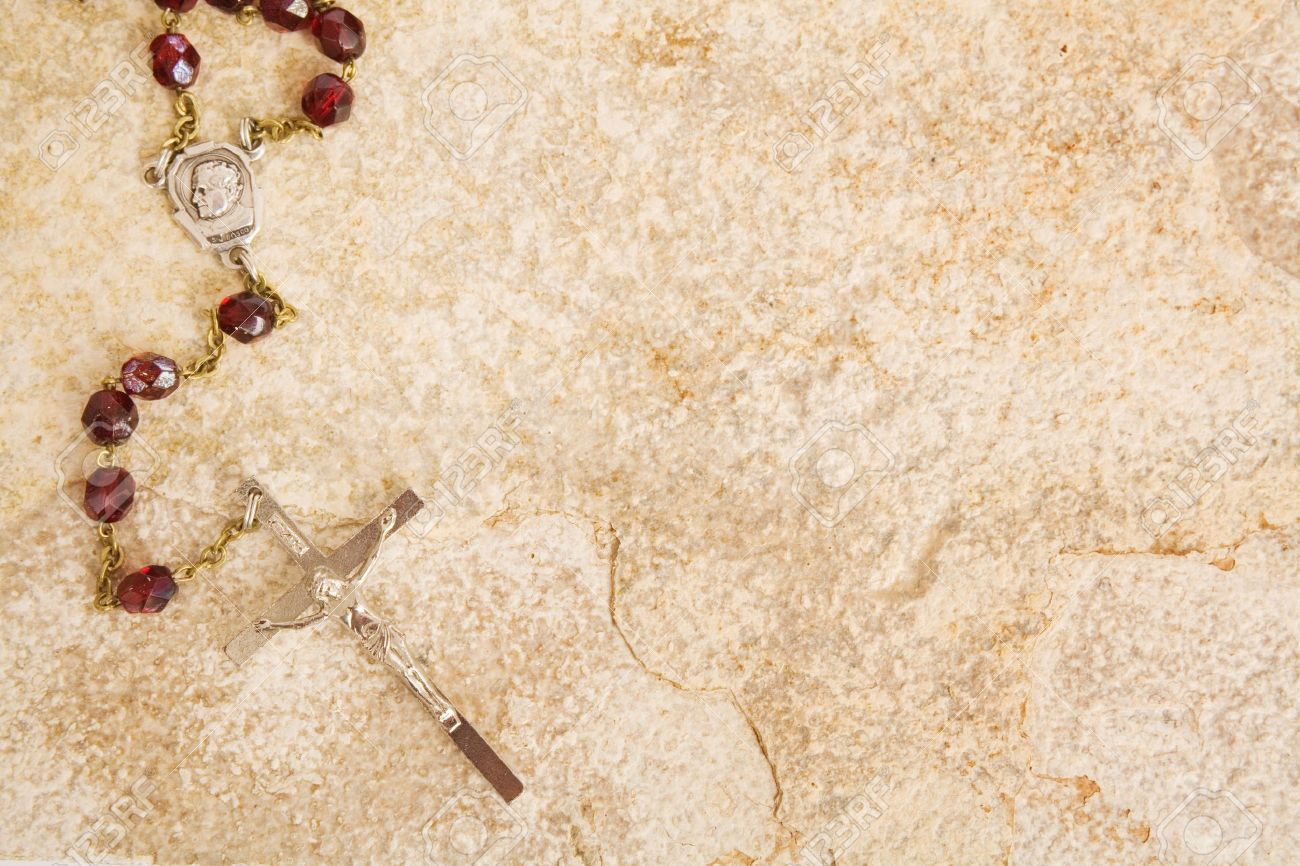 Rosary beads on a sandstone background Stock Photo - 4832742