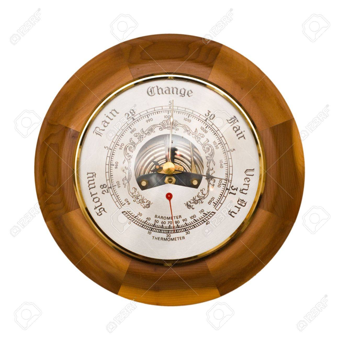 Traditional wooden barometer and thermometer isolated on a white background Stock Photo - 4948292