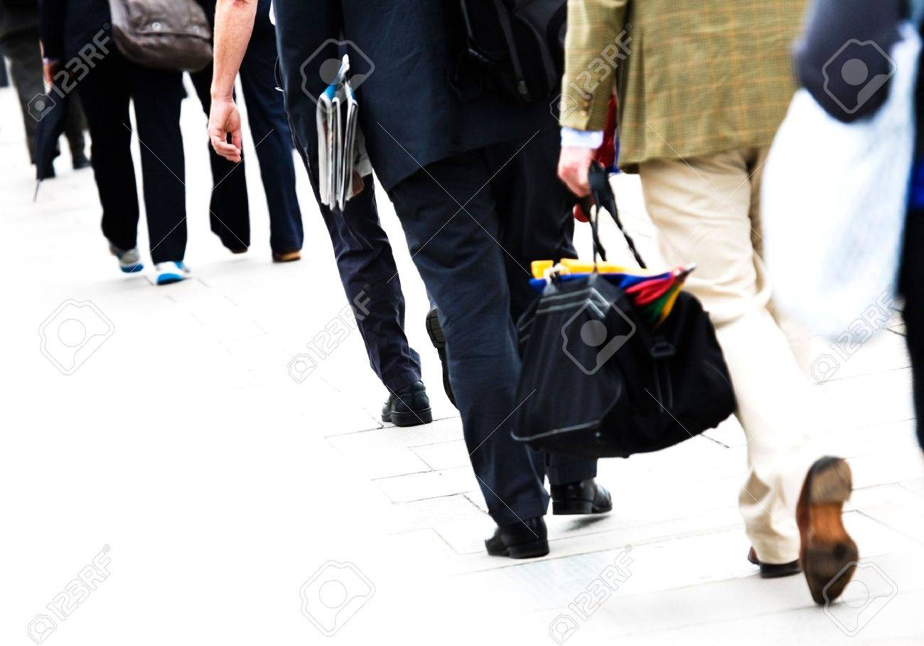 commuters in casual business dress walk to work isolated on commuters in casual business dress walk to work isolated on white background stock photo