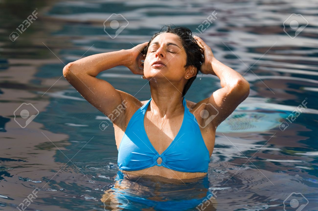 An Athletic Indian Woman In Blue Bikini Relaxes In A Swimming Pool Stock Photo 6174394