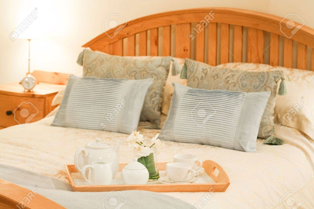 Room service tray on a bed in a luxury hotel bedroom with cozy bedlinen Stock Photo - 6483186