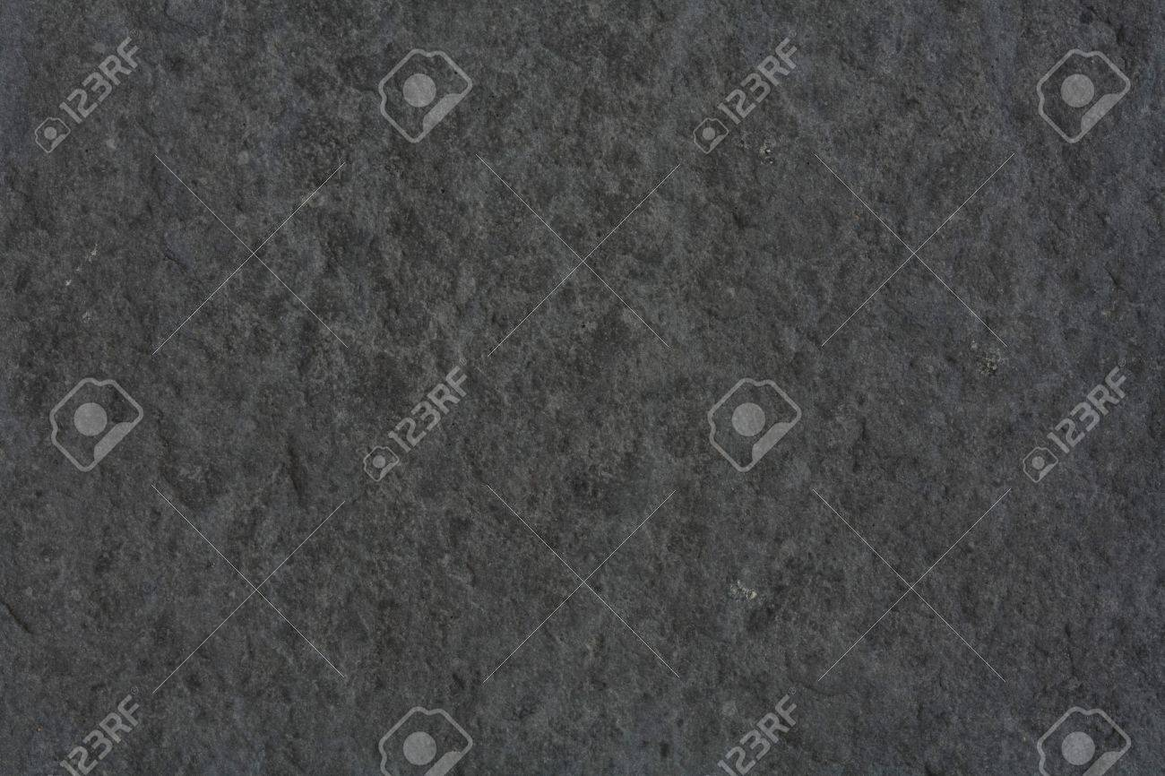 Smooth shaped white stones surface texture background stock photo - Grey Rocks Rough Textured Background In Dark Gray Stone