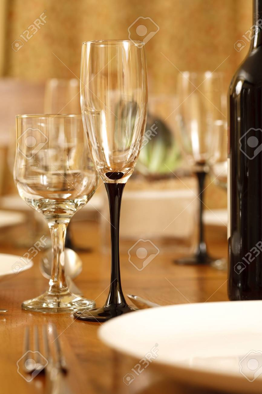 Elegant Dining Table With Wine Glasses And White Crockery Stock Photo   9311419