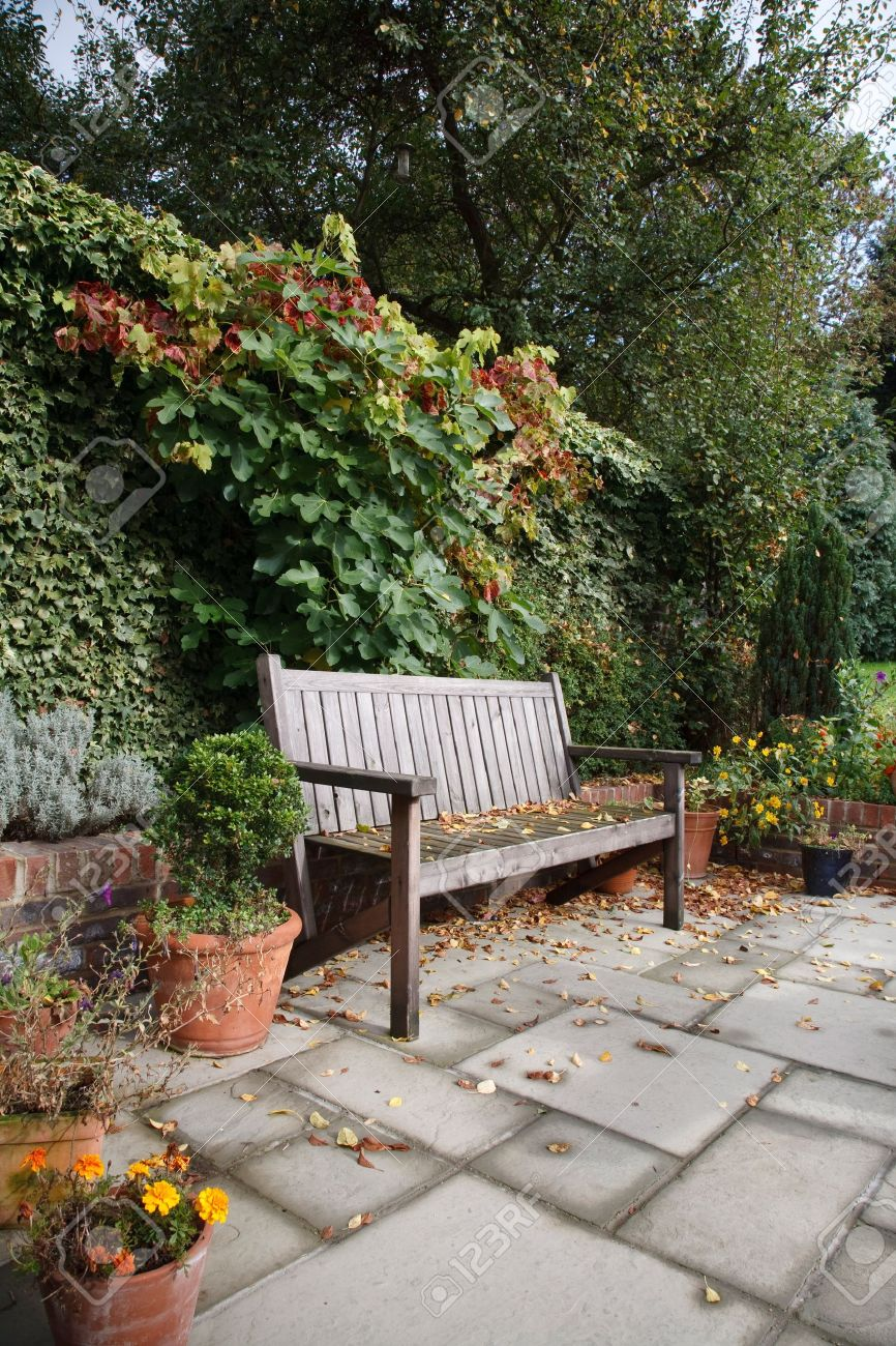 garden furniture an informal english garden in autumn with traditional wooden bench flagstones and