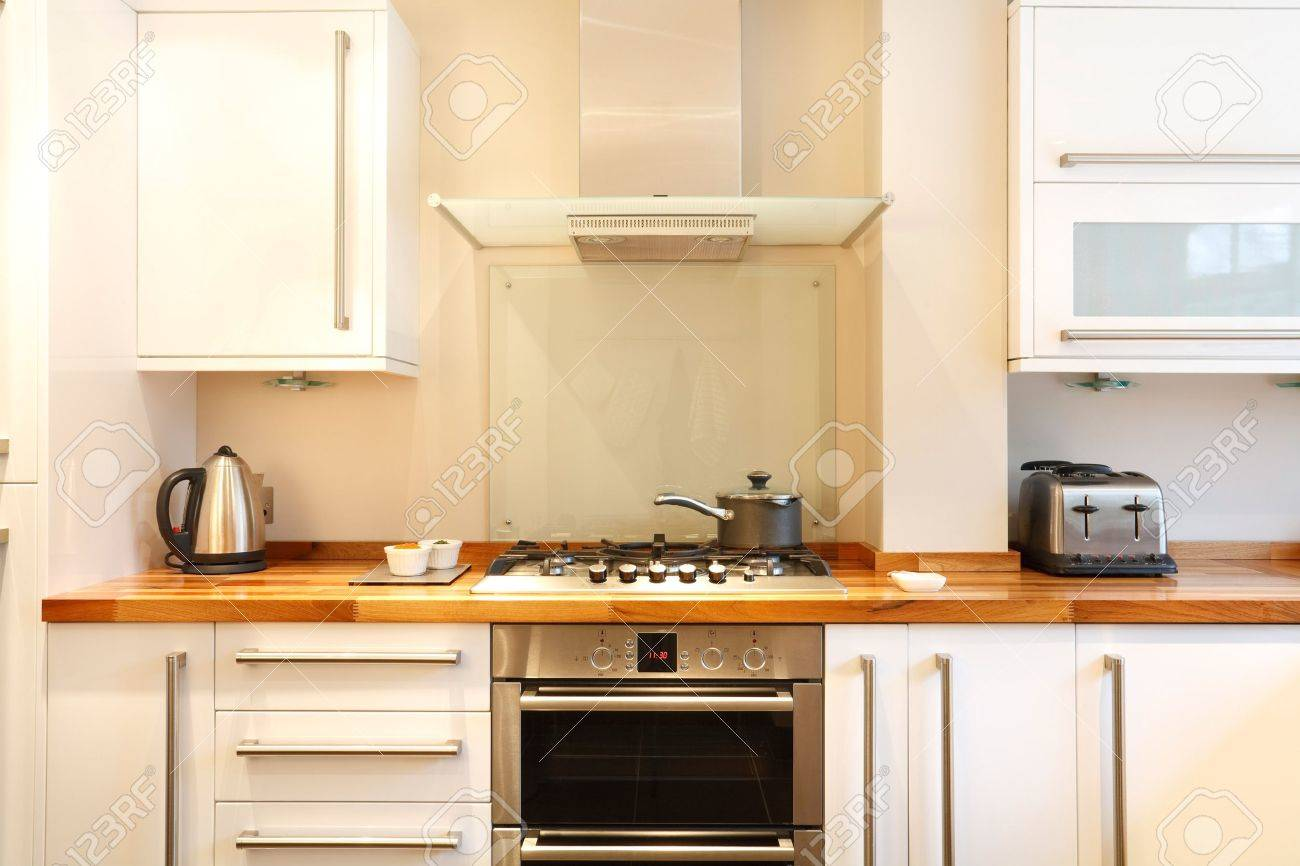 Beau Modern Kitchen With A Gas Hob, Chimney Hood, Wooden Worktops And Stainless  Steel Appliances