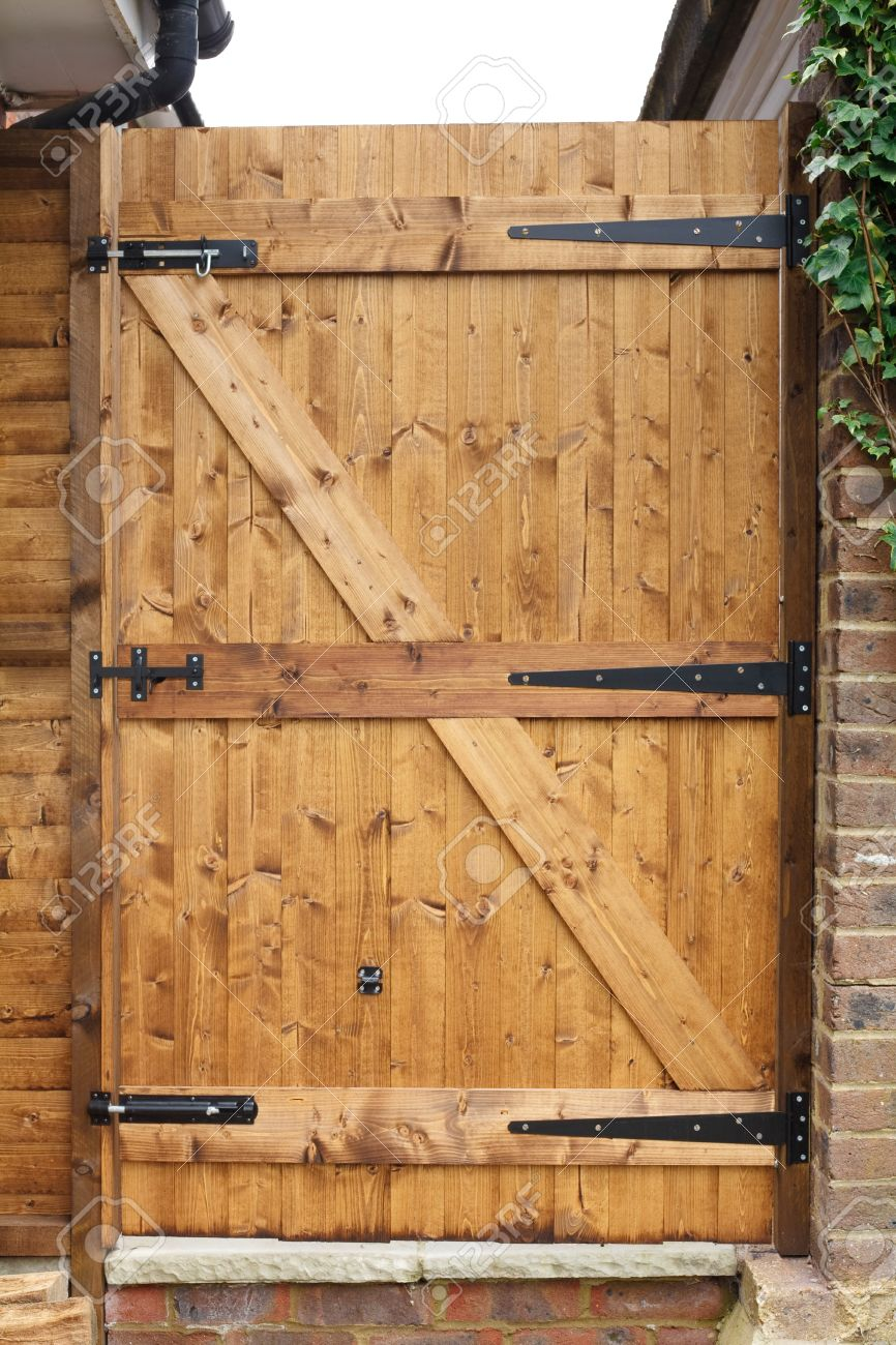 Stock Photo - Tongue and groove exterior wooden garden door with cast iron hinges & Tongue And Groove Exterior Wooden Garden Door With Cast Iron.. Stock ...