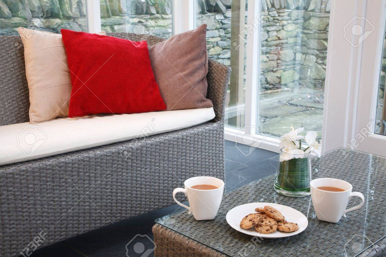 Conservatory interior design with rattan chairs and coffee table Stock Photo - 11816424