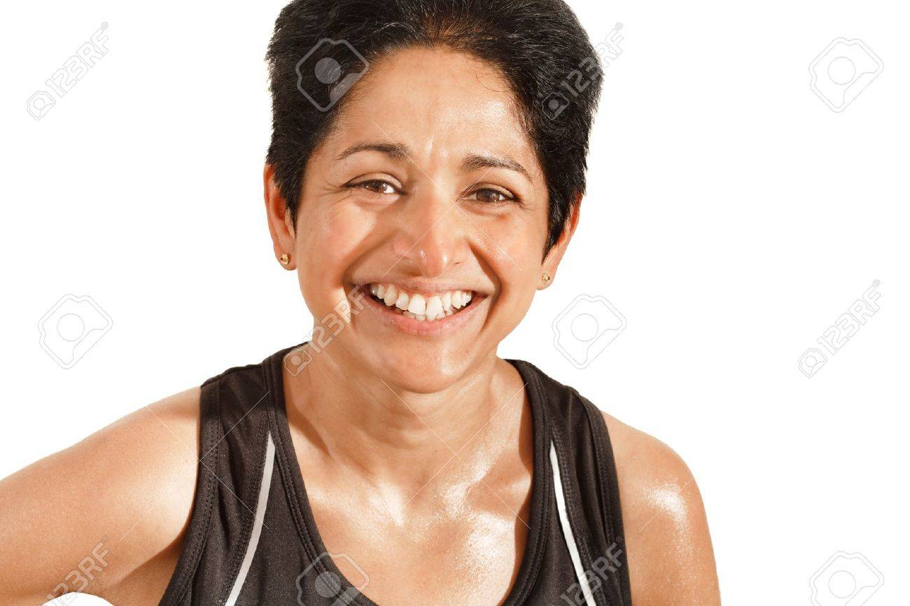 Athletic Indian woman smiling, isolated against a white background with clipping path Stock Photo - 14282744