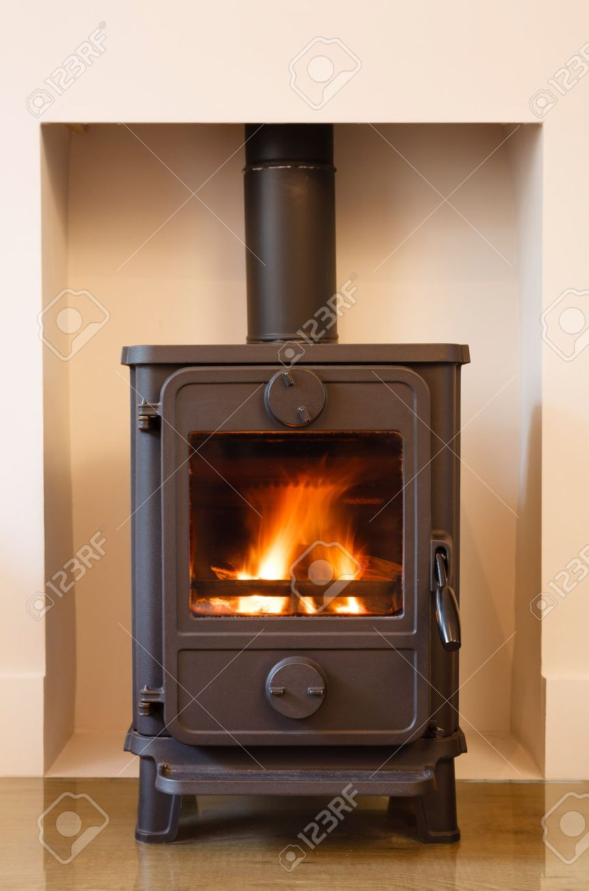 Cast iron wood burning stove in a modern contemporary fireplace Stock Photo  - 14809592 - Cast Iron Wood Burning Stove In A Modern Contemporary Fireplace