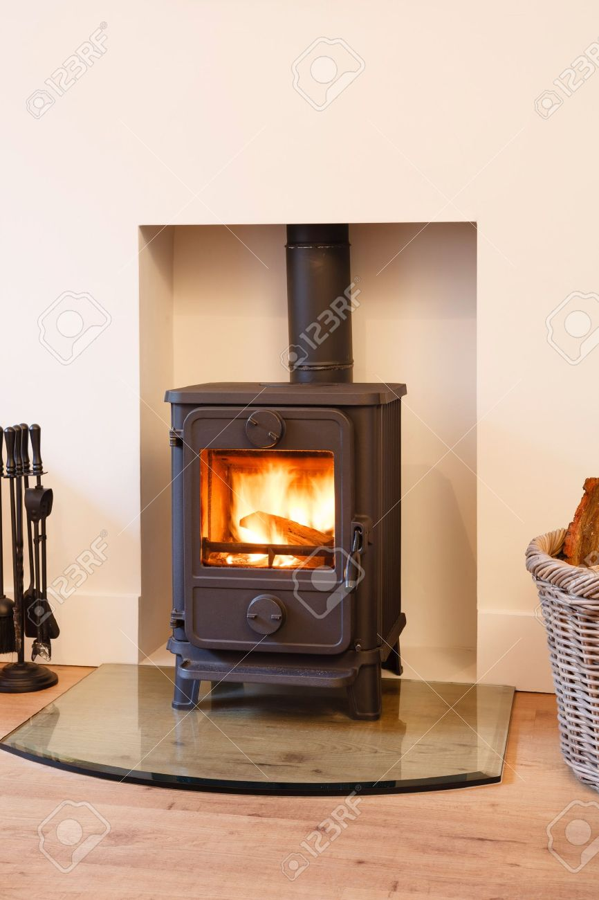 Cast iron wood burning stove in a modern contemporary fireplace Stock Photo - 15368785