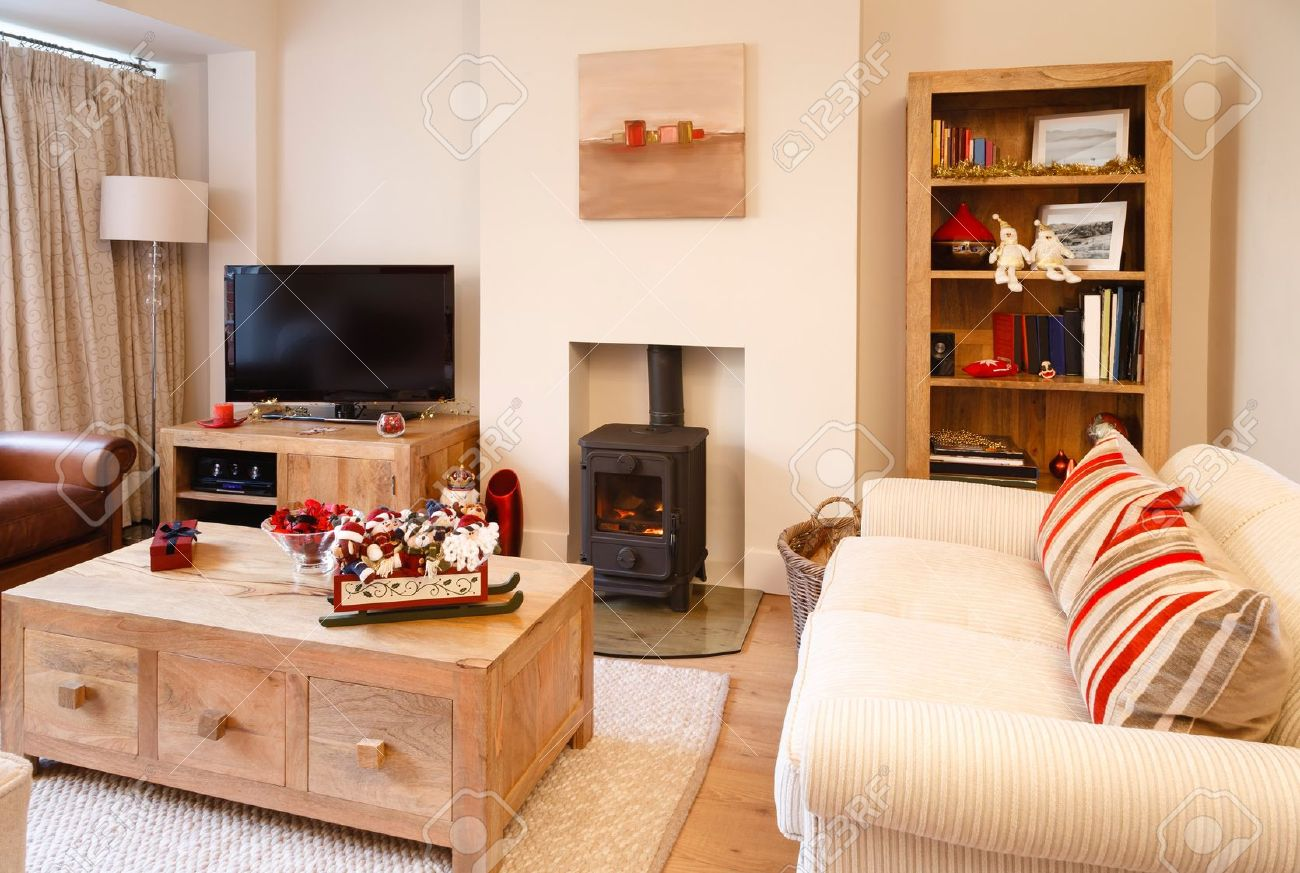 Contemporary Interior Design Living Room With Christmas Ornaments Photographers Own Artwork On Wall And Bookcase Stock