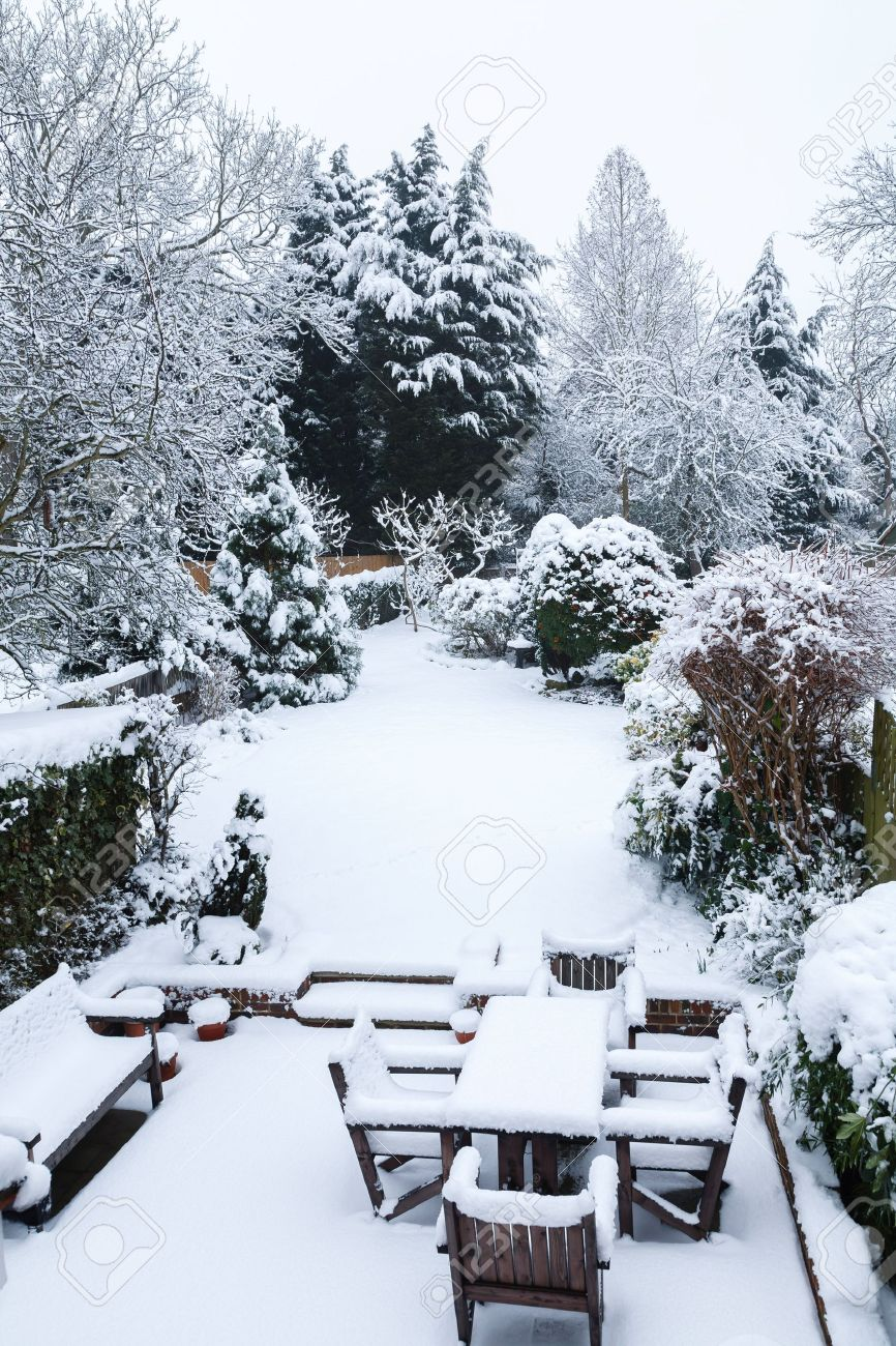 Suburban winter garden and patio furniture covered with snow Stock Photo - 15368789