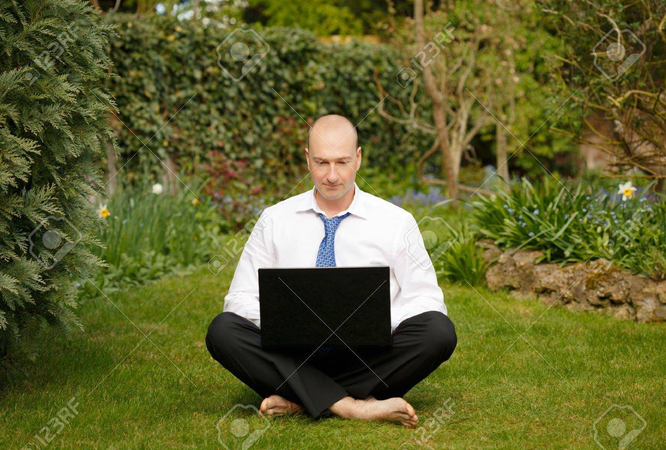 Successful businessman in white shirt and tie working and relaxing outdoors Stock Photo - 15812381
