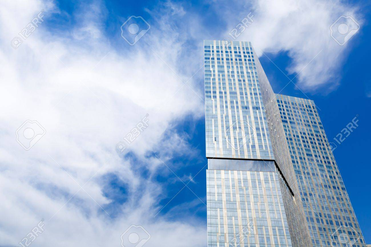 Modern glass skyscraper against a blue sky with copyspace Stock Photo - 17327178