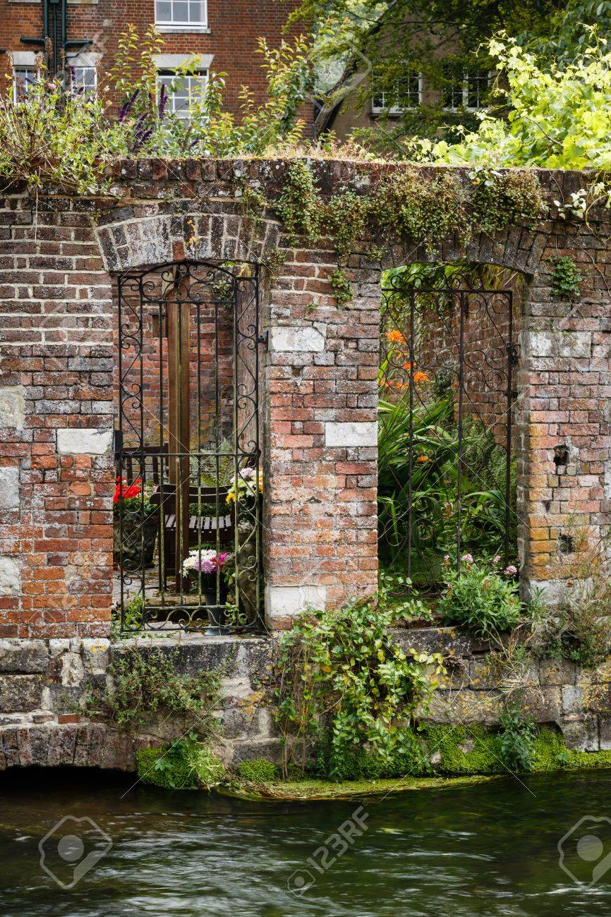 Walled Garden On A Riverbank In Winchester, Hampshire, UK Stock ...