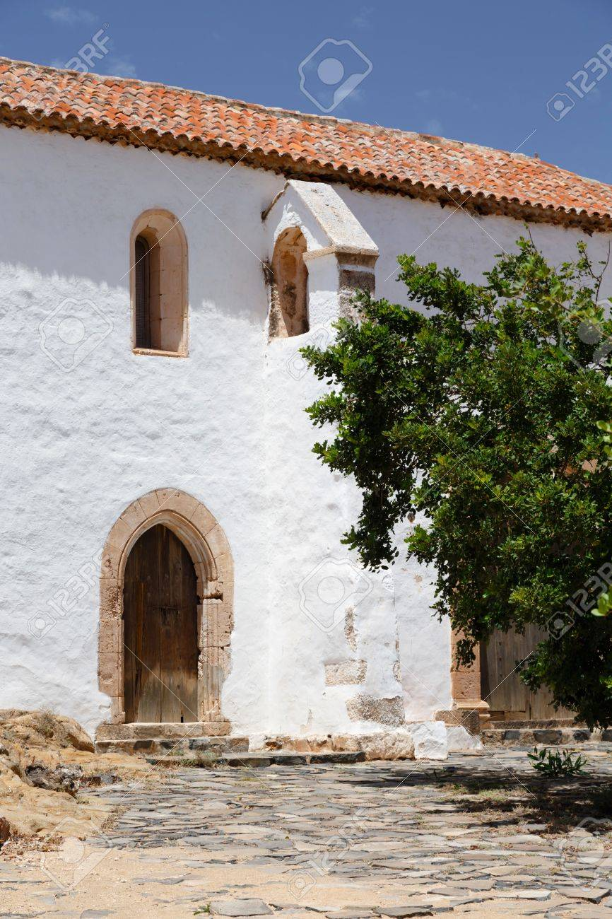 Old White Building Depiciting Traditional Spanish Architecture Stock Photo