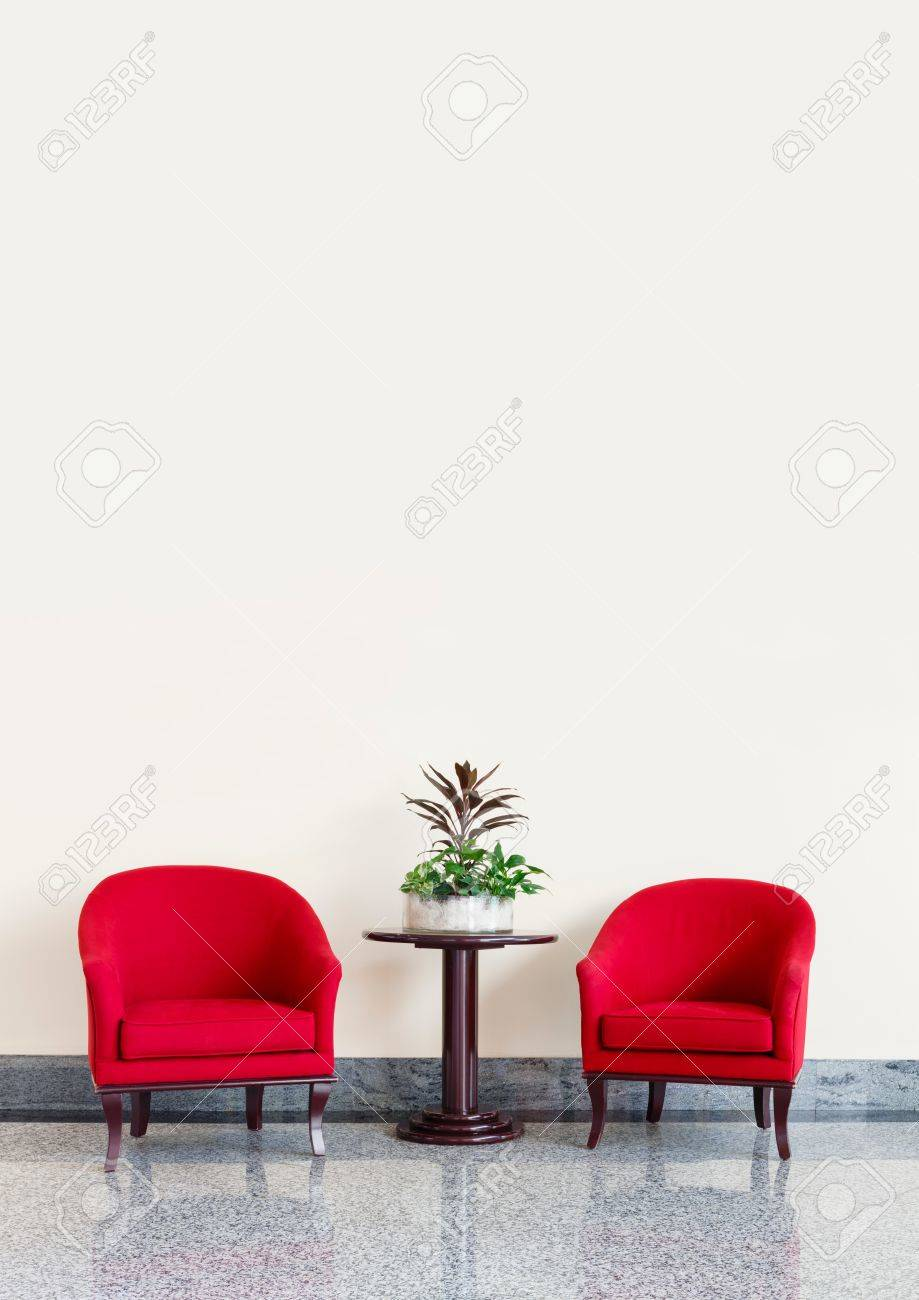 Red Armchairs Against A Neutral Wall Background With Copyspace Stock Photo    60232450
