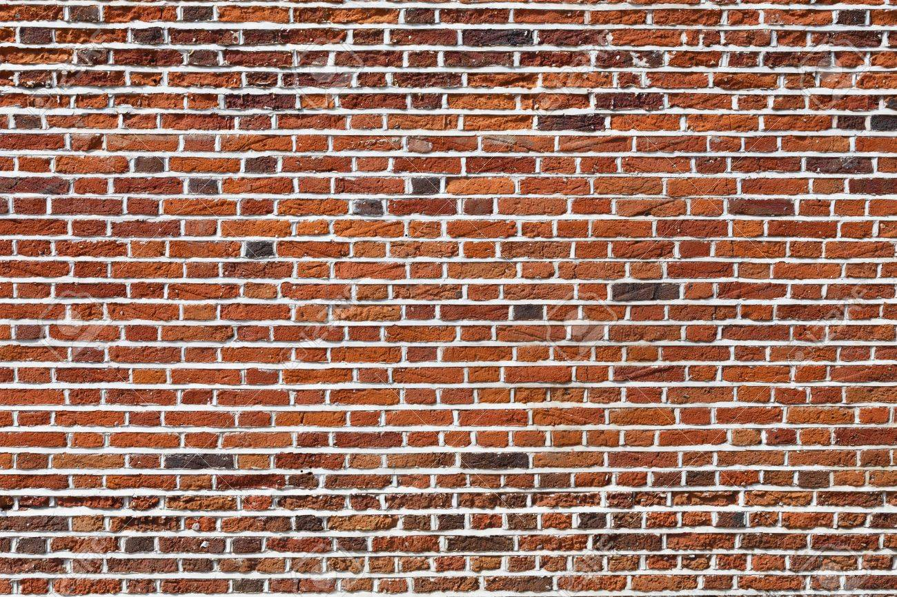 Red brick wall, ideal for a background - 63664402