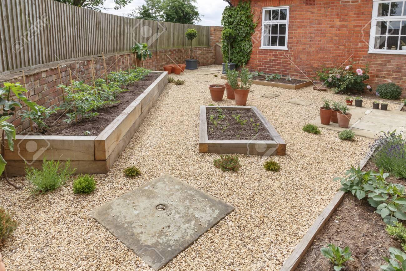 Oak Sleeper Raised Beds In A Courtyard Garden Design With Hard