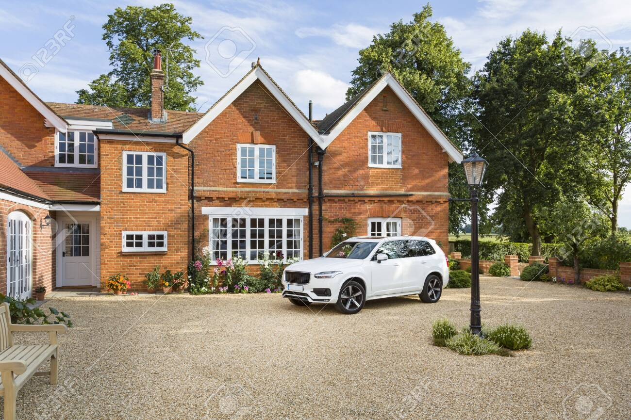 Large executive mansion house and luxury car in a rural setting, Buckinghamshire, England, UK - 130100344