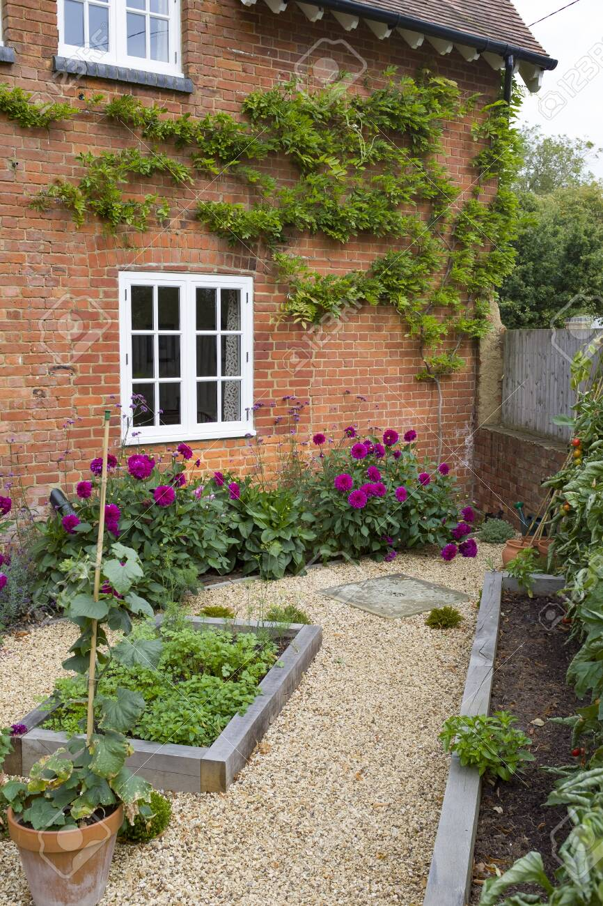 Picture of: Small English Courtyard Garden In Uk With Oak Sleeper Raised Stock Photo Picture And Royalty Free Image Image 138941224