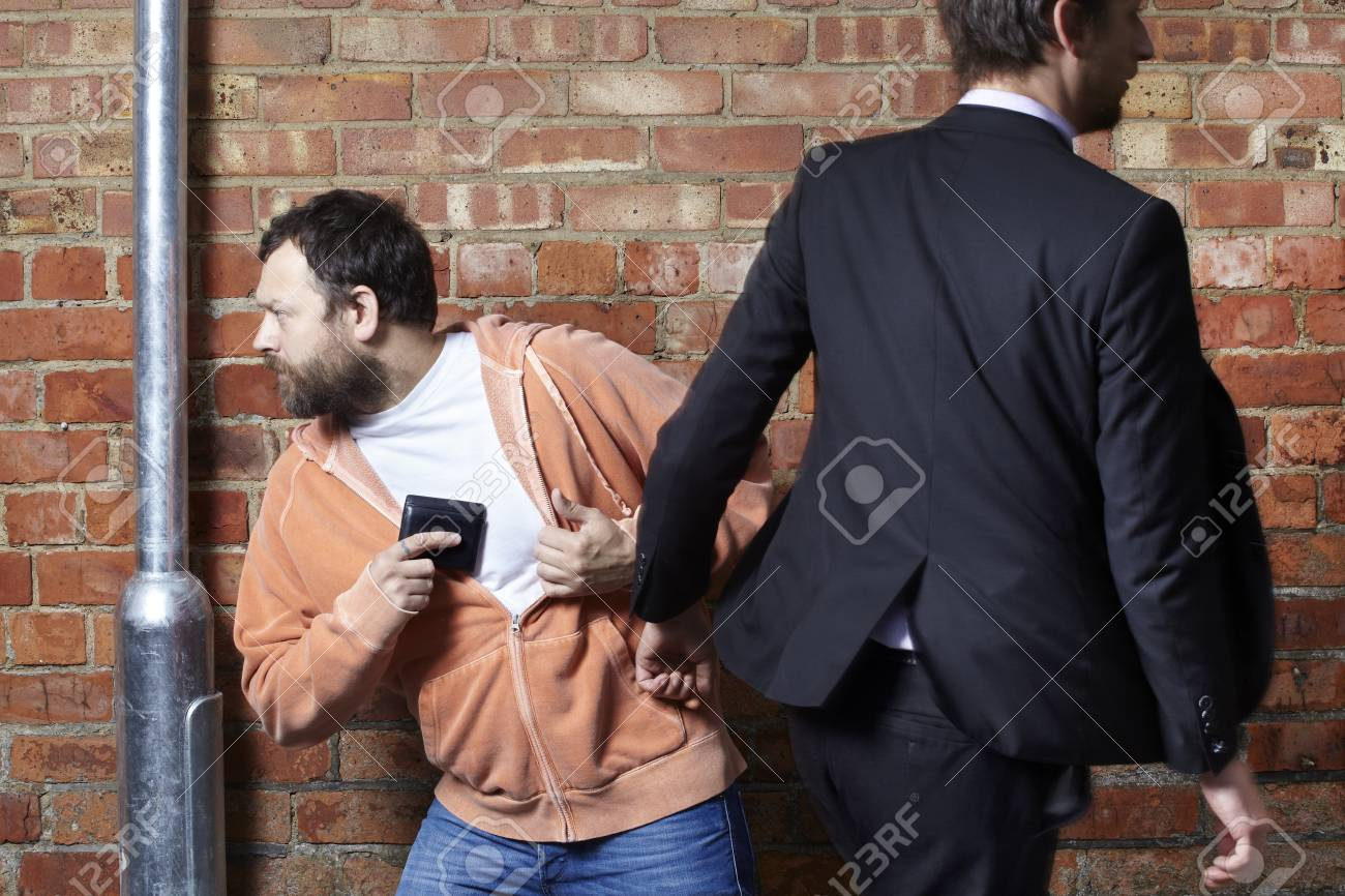 Man has his wallet pickpocketed whilst walking along the street Stock Photo - 14597539