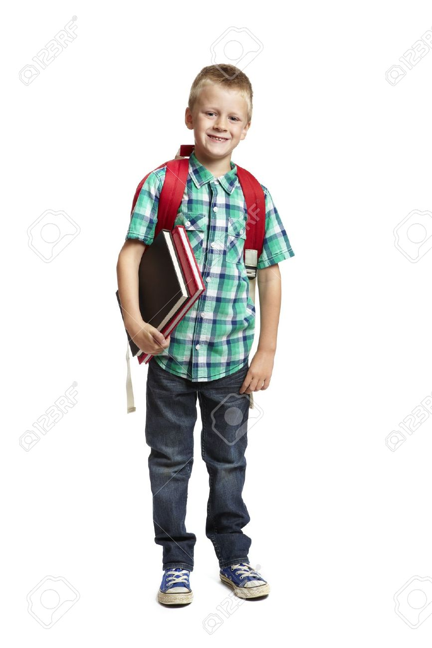 8 year old school boy with backpack holding books on white background Stock Photo - 14795412