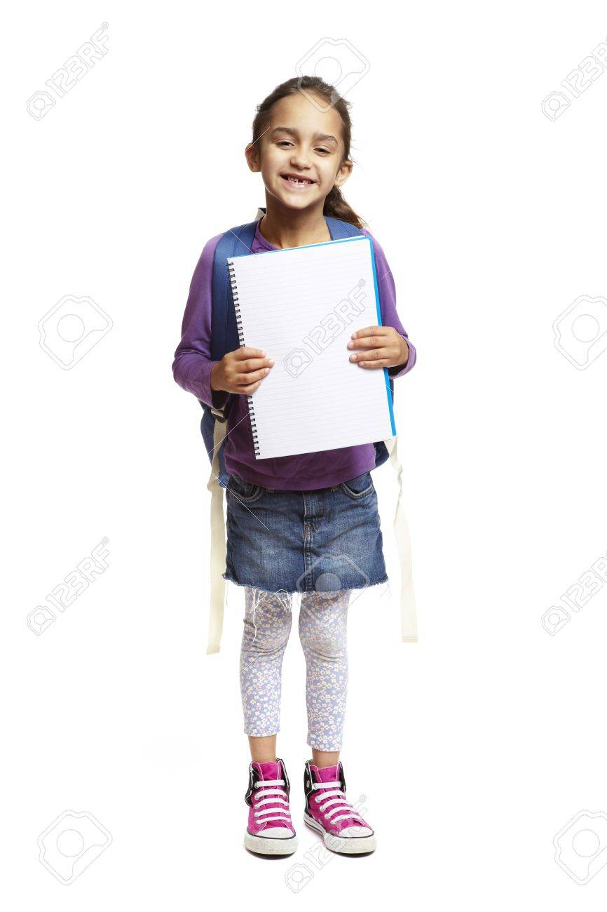 37c2a5296f4c 8 year old school girl with backpack holding blank notepad smiling on white  background Stock Photo