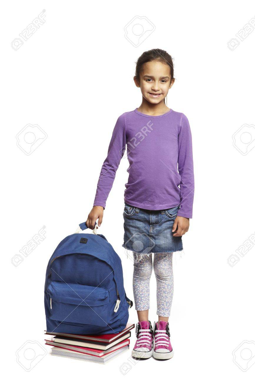 ca4c6d2db8 8 year old school girl with books and backpack on white background Stock  Photo - 14795497