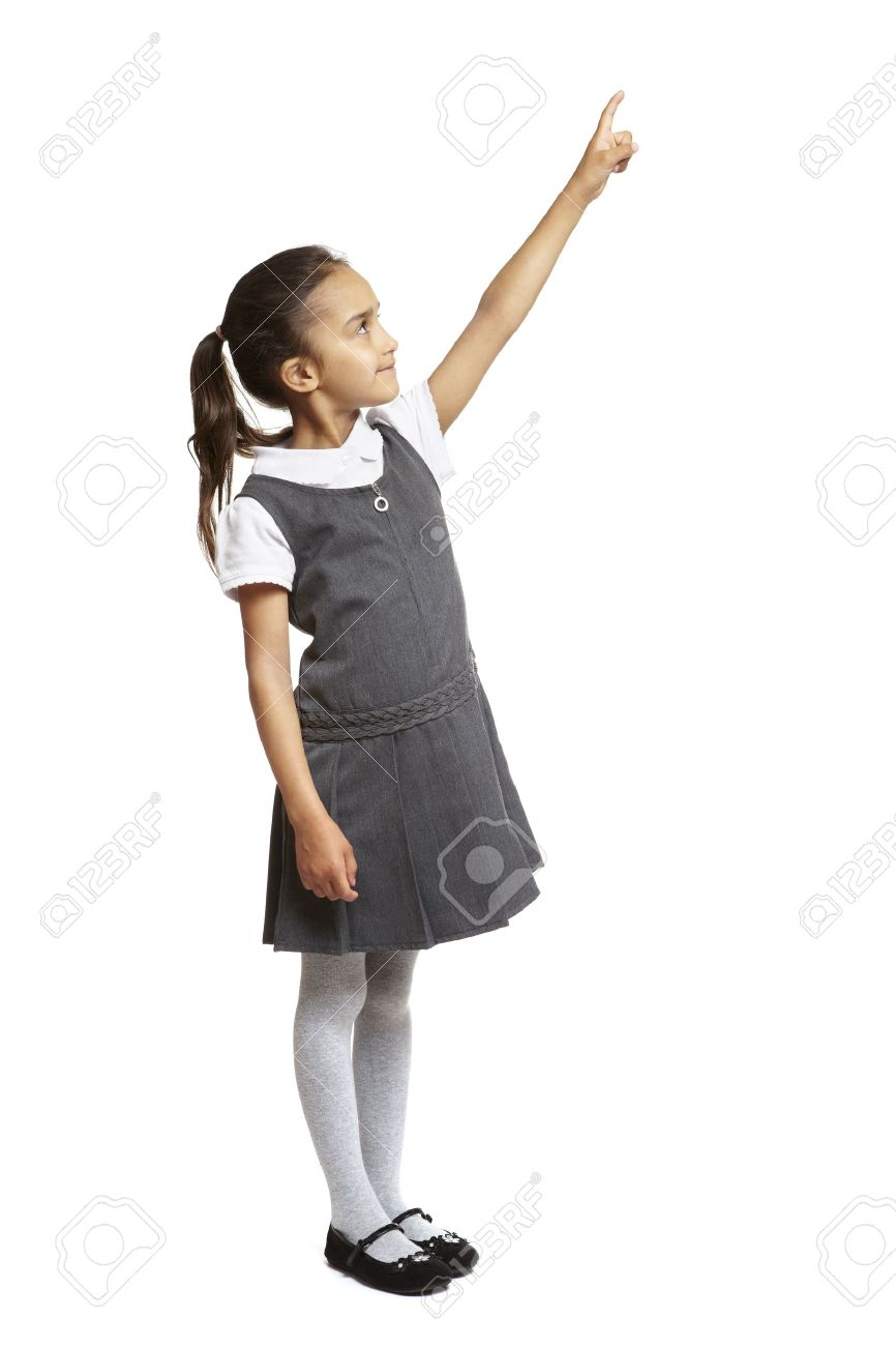 fb935726ff 8 year old school girl pointing up smiling on white background Stock Photo  - 14823951