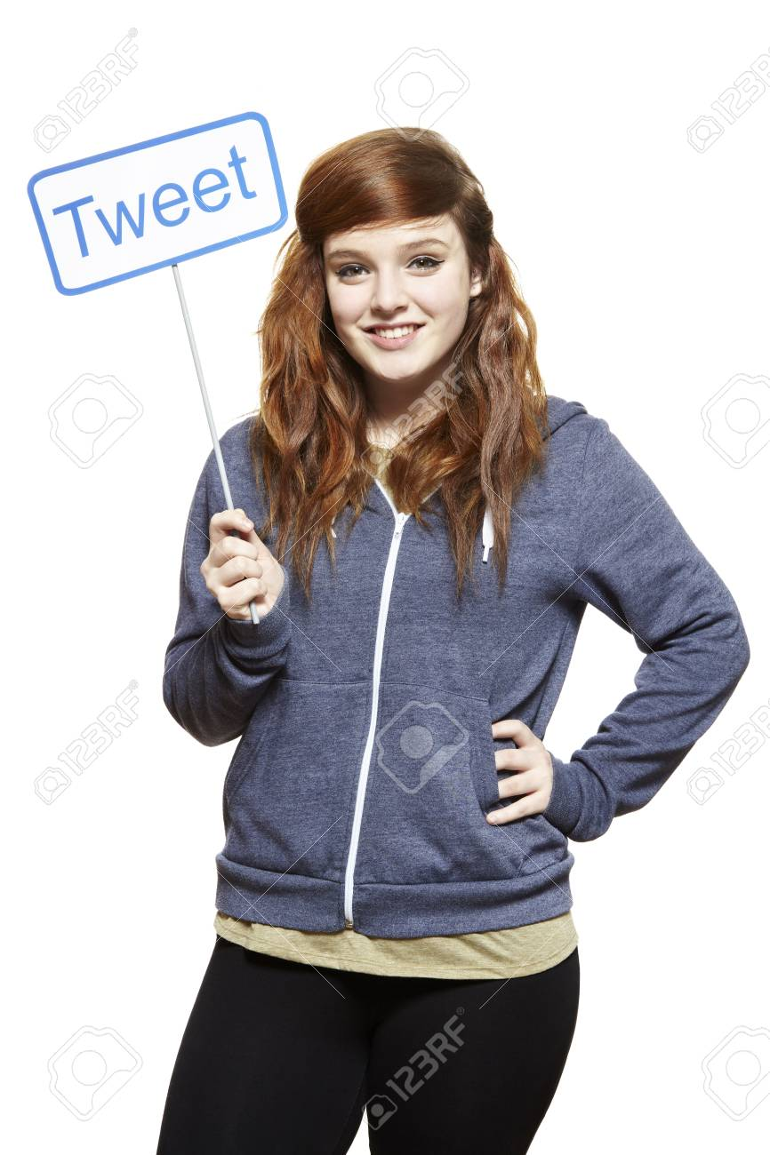 Teenage girl holding a social media sign smiling on white background Stock Photo - 18714821