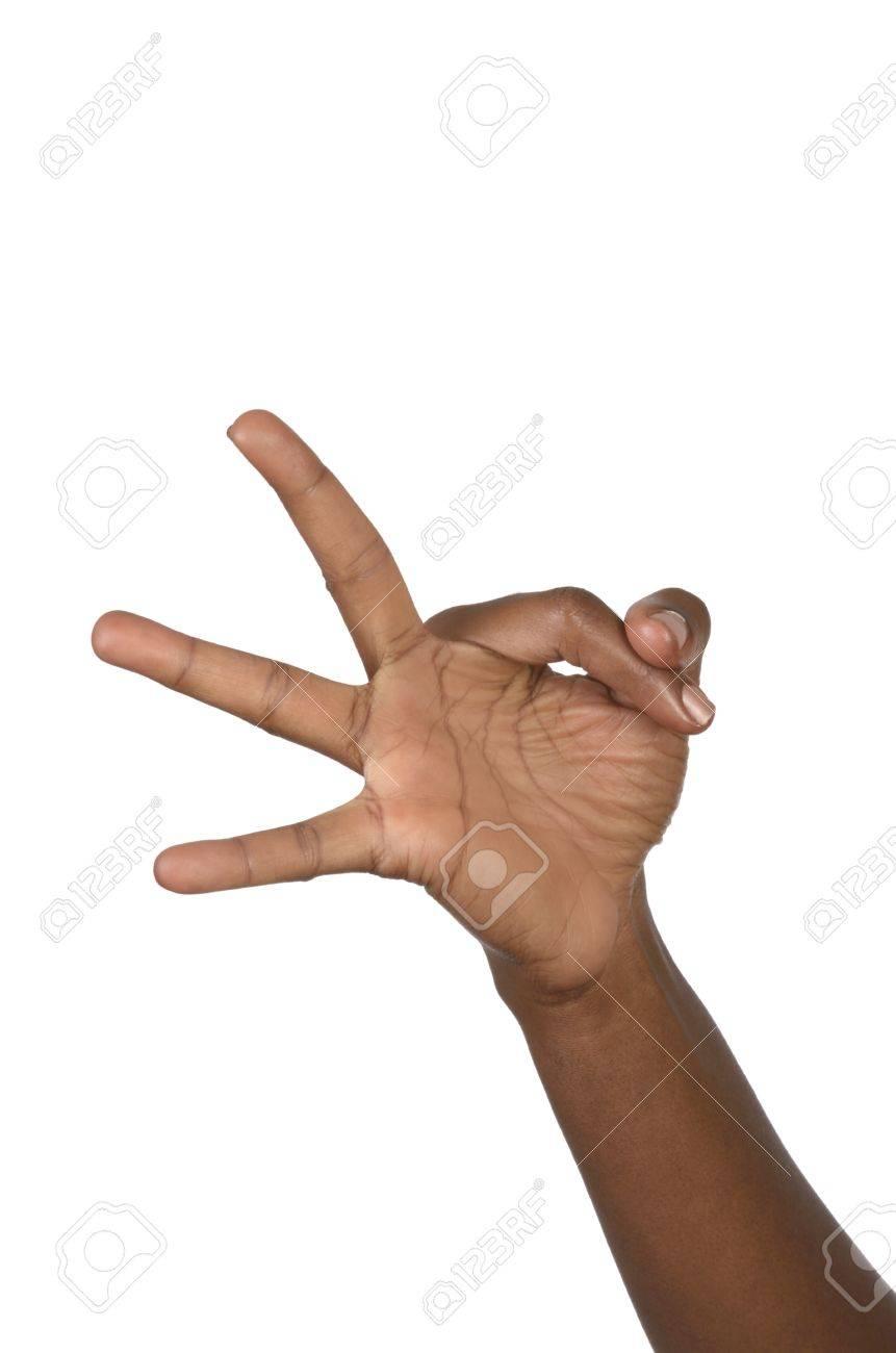 Hand shows three fingers, studio shot, isolated Stock Photo - 17958382