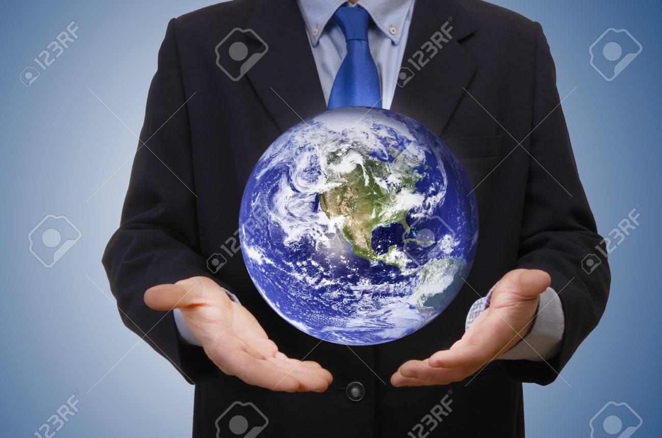 Business man holding planet, studio shot Stock Photo - 18424693