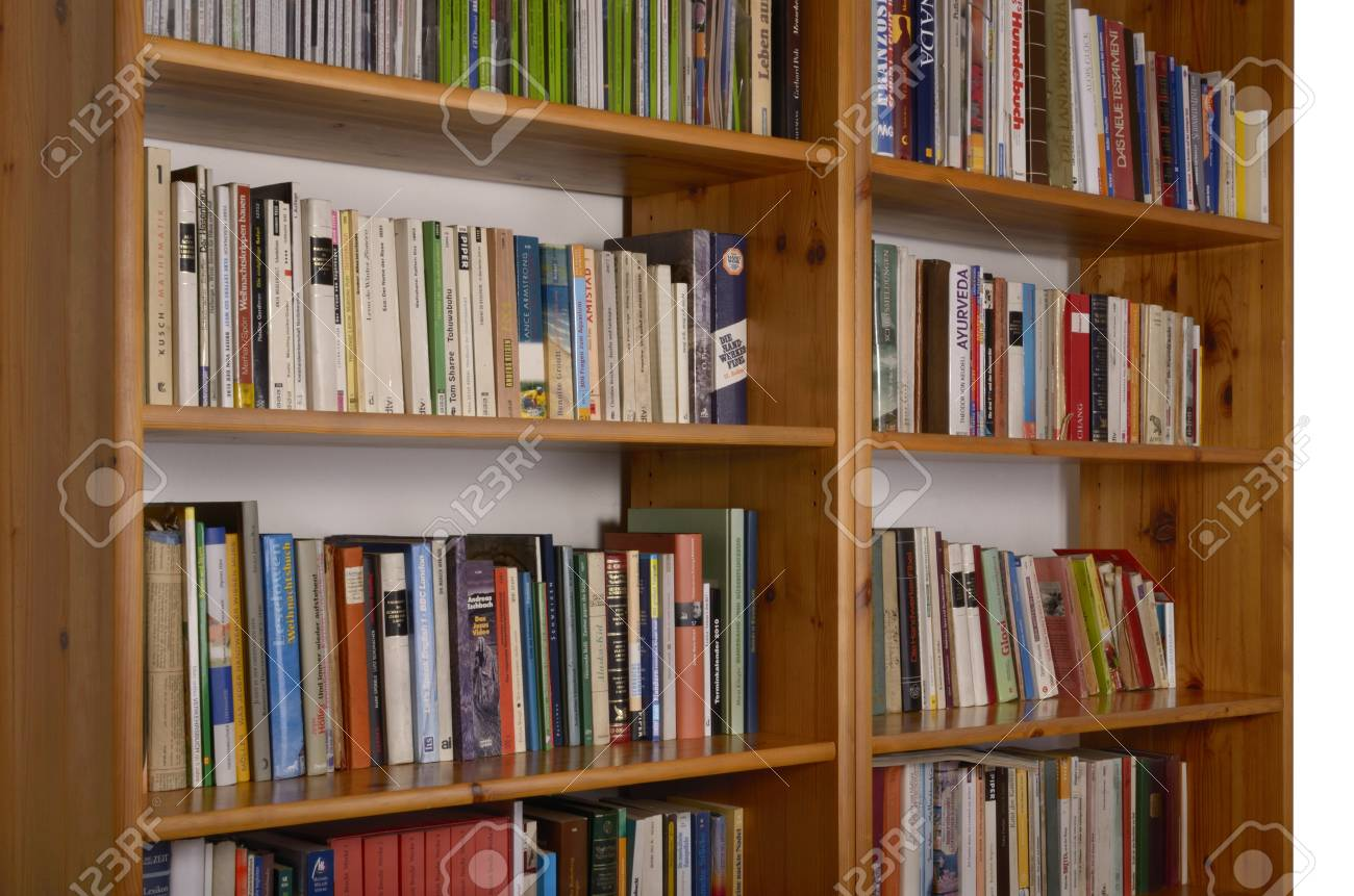 Bookshelf With Books And Magazines German Titles Stock Photo
