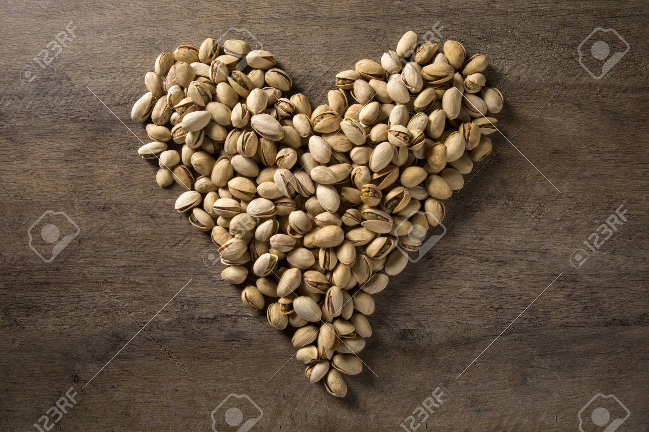 pistachio nuts in the form of a heart - 79008358