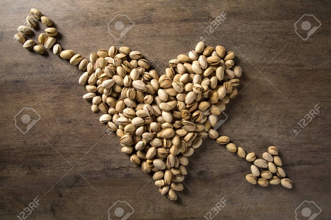 pistachio nuts in the form of a heart - 79008392