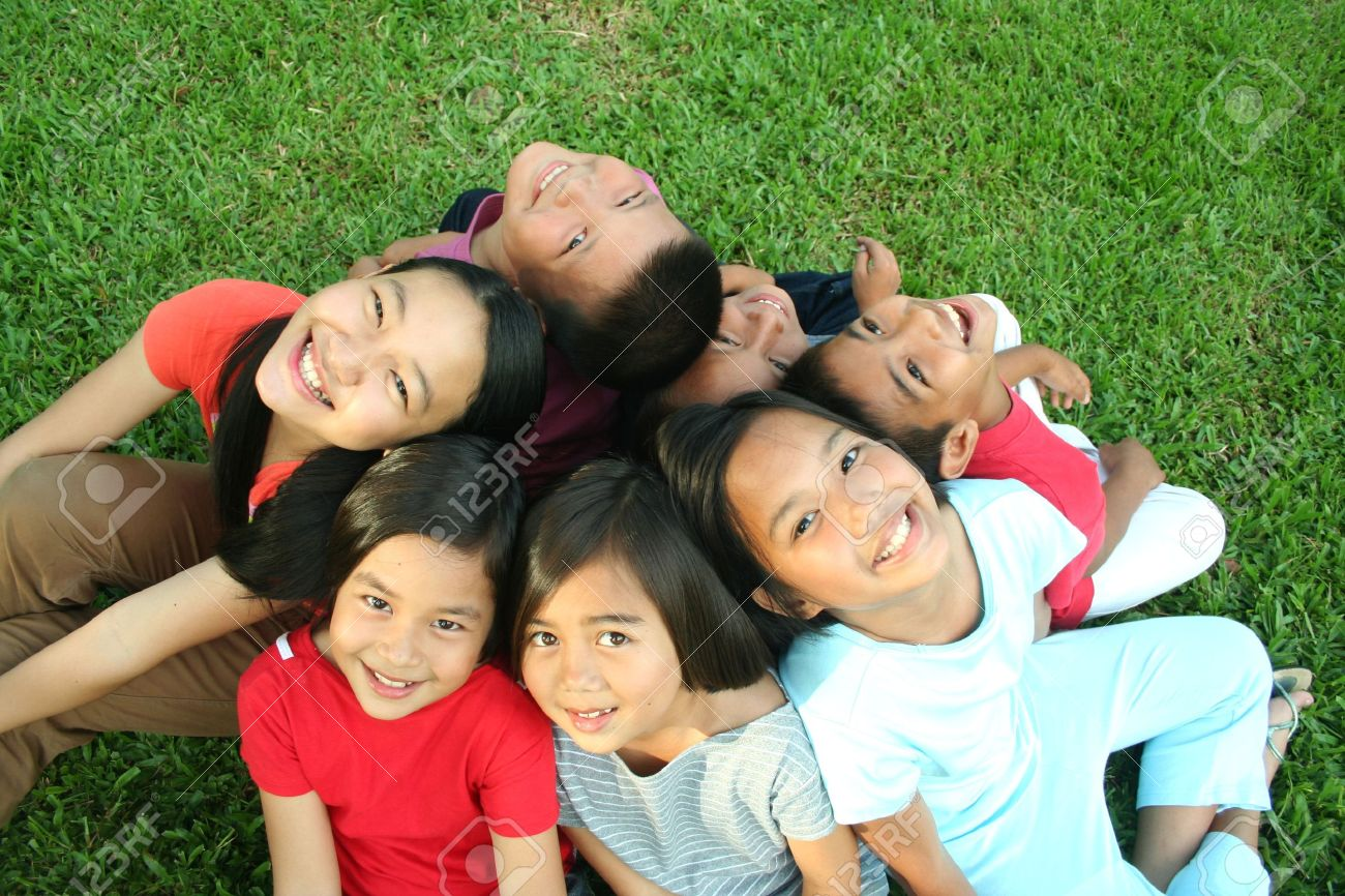 Asian children having fun in the park. Stock Photo - 8778797