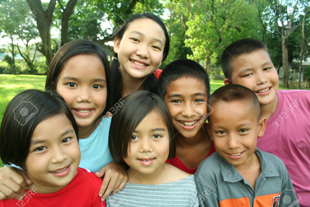 Asian children having fun in the park. - 9161764