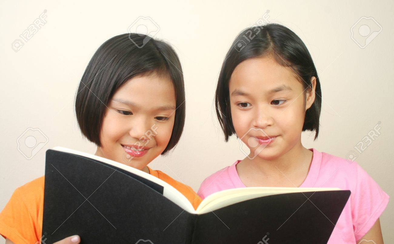Two girl reading book Stock Photo - 13421859